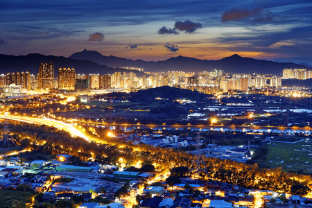 Famed skyline of Hong Kong  Yuen Long downtown sunset photo