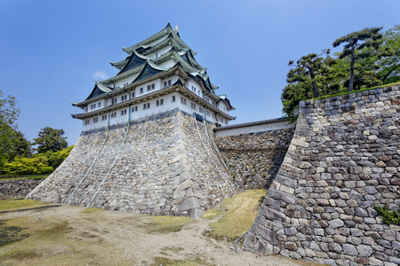 atop: Nagoya castle atop with golden tiger fish head pair called King Cha Chi, Japan