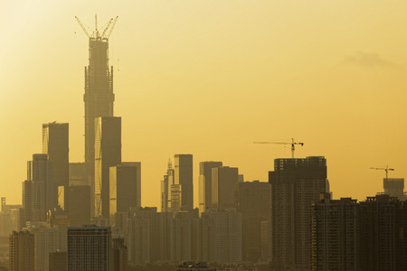 Air pollution scenic in countryside with building and yellow smoke in hong kong city at sunset photo