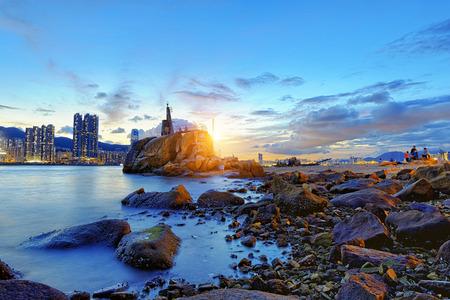 Hong Kong Sunset, Yau Tong Lei Yue Mun water bay and lighthouse 版權商用圖片