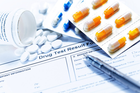 drugs: Drug test blank form with Variety of medicines Stock Photo