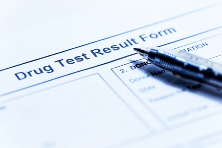 Drug test blank form with pen 스톡 콘텐츠
