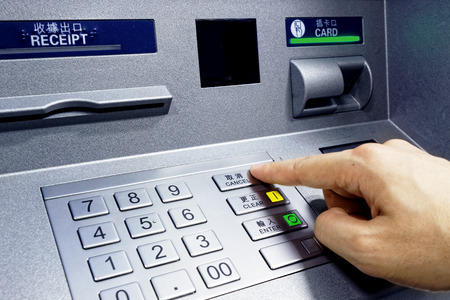 personal banking: ATM - entering pin close up