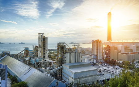 factory line: Glow light of petrochemical industry on sunset. Stock Photo