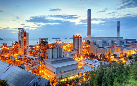 heavy industry: Glow light of petrochemical industry on sunset. Stock Photo