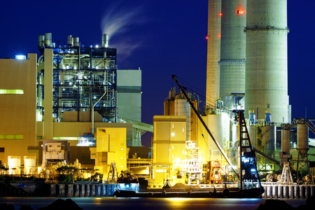 infrastructure buildings: power station at night with smoke , hong kong Stock Photo