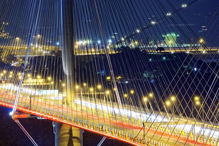 light traces: highway bridge at night with traces of light traffic, Ting Kau bridge at hong kong.