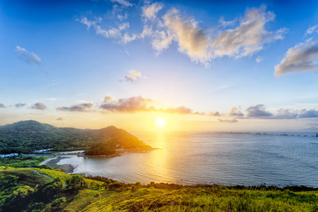 Village with beautiful sunset over hong kong coastline. View from the top of mountain Stock Photo - 47221408
