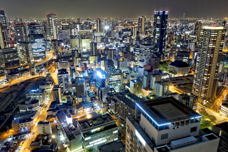 city traffic: Osaka, Japan city skyline at the landmark Umeda District.