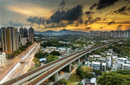 cityspace: hong kong cityspace and speed train at sunset