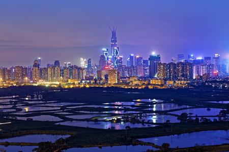 hongkong: Shenzhen cityscape at night , view from hong kong countryside