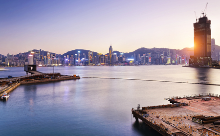 comercial: Hong Kong comercial container port at sunset Stock Photo
