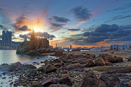fishing village: Light House at sea Cove at Sunset , hong kong fishing village