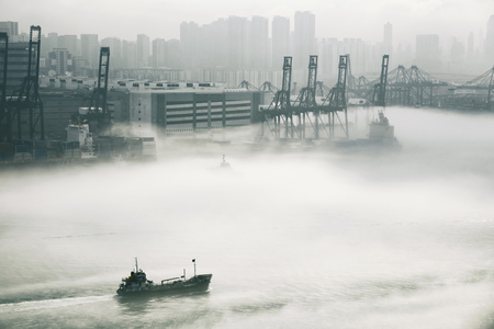 steel: Hong Kong cargo port in mist Stock Photo
