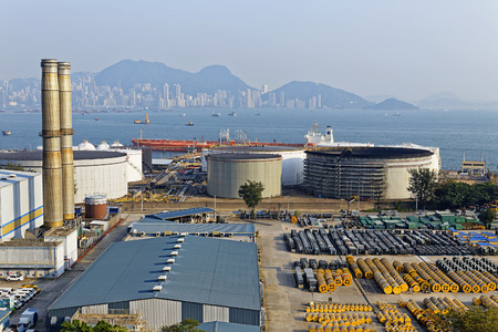 emission: petrochemical industry on sunset , hong kong coal power station and oil tank