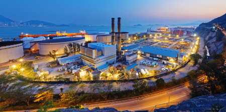 industria petroquimica: petrochemical industry on sunset , hong kong coal power station and oil tank