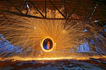 steel wool: Burning Steel Wool spinning. Showers of glowing sparks from spinning steel wool in ruins