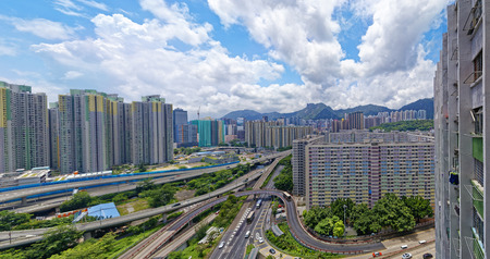 overcrowded: hong kong public estate buildings with landmark lion rock at day Stock Photo