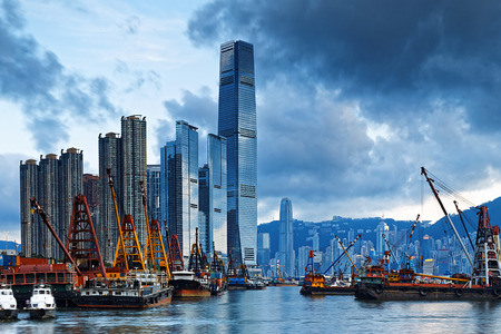 icc: International Commerce Center ICC Building Kowloon Hong Kong Harbor with cargo ship Editorial