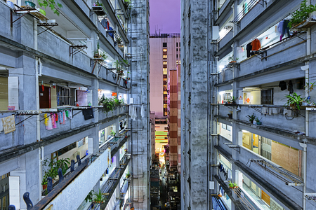 overcrowded: Hong kong slum downtown area at night Editorial