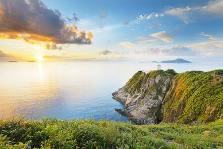 beautiful sky: Hong Kong lighthouse during sunrise , Hok Tsui Cape DAguilar beautiful landscape