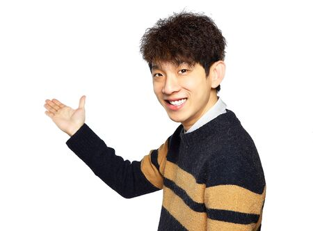holds: Asian young business man hold show open empty palm, happy smile, concept of advertisement product, empty copy space wear sweaters isolated over white background