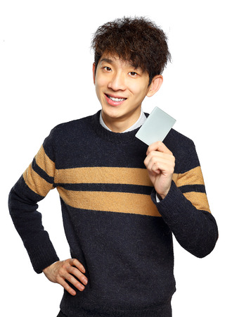 man holding card: Asian young man holding card on white background Stock Photo