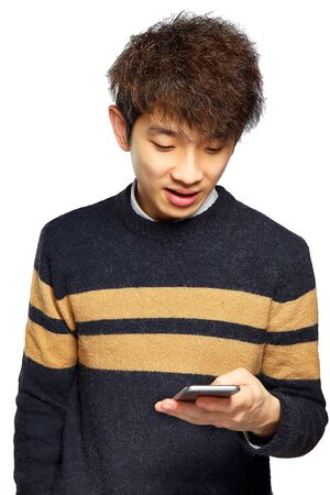mobile sms: Young man using mobile phone SMS on white background
