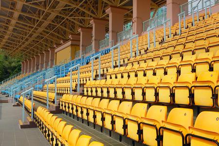 plastic seats in stadium at day Stock Photo