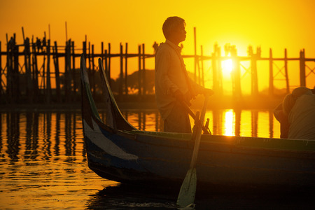 fishman: Fishman under U bein bridge at sunset, Myanmar landmark in mandalay