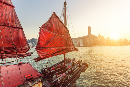 Sailboat In Hong Kong Harbour at sunset.