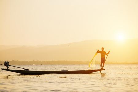 Fisherman of Lake in action when fishing, Myanmar (Burma)