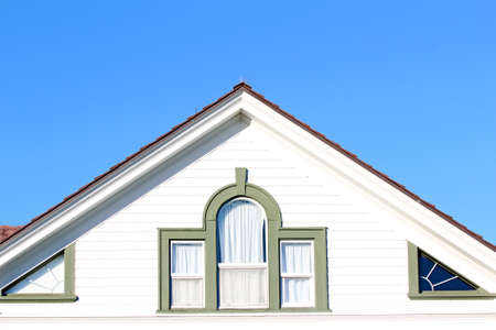A roofline showing loft windows Stock Photo