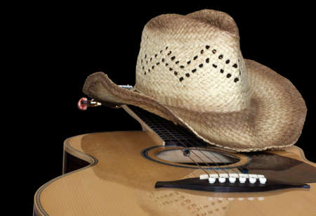 acoustic guitar with hat isolated on black Stock Photo