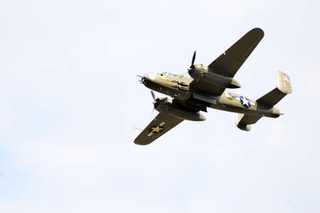 A B25J Mitchell bomber in flight with bomb bay doors open