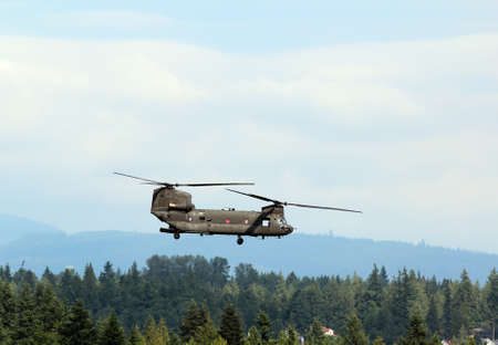 A CH-47 Chinook Helicopter in flight Editorial