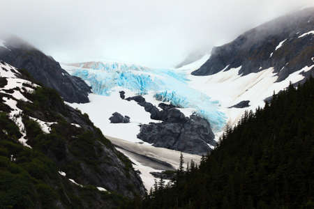 One of the many mountain top diminishing glaciers in Alaska photo