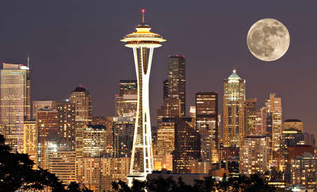 The lights come on in Seattle with a full moon Stock Photo - 14756735
