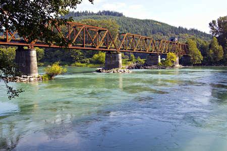 skagit: The now abandoned warren through truss swing span bridge over the Skagit River in Skagit County, Washington, USA. Stock Photo