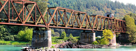 river county: The now abandoned warren through truss swing span bridge over the Skagit River in Skagit County, Washington, USA. Stock Photo