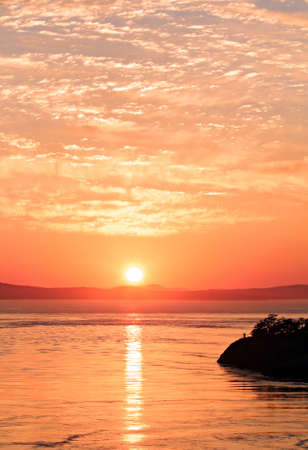 View of beautiful sunset from Deception Pass photo