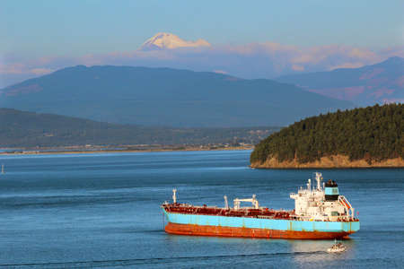 padilla: Oil tanker ship in Padilla Bay, Anacortes, Washington State with Mt Baker in the background. Stock Photo