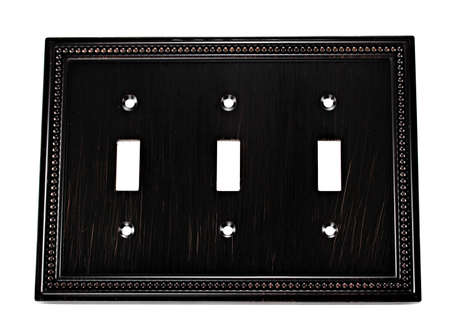 dimmer: Ornate triple light switch cover Stock Photo