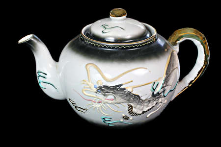 cultural artifacts: Antique ornate Chinese dragon tea pot