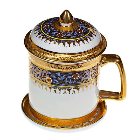 old items: Ornate Thai benjarong mug with saucer and lid Stock Photo