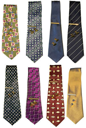A set of mens neckties isolated on white with gold cufflinks and tie clasp photo