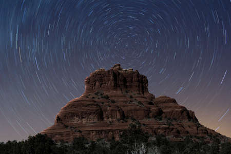 A view of Bell Rock at night with stars rotating photo
