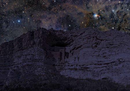 dwellings: Montezuma Castle cliff dwellings at night.  Stock Photo