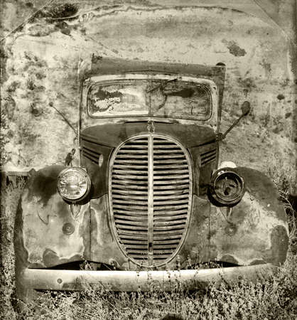 rusty car: An old rusted and abandoned truck with grunge