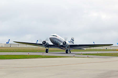 undertaken: MUKILTEO - MARCH 02  DC-3 N877MG inaugural flight on March 20, 2013 in Mukilteo, Washington  The DC-3 re-enters service after an extensive restoration undertaken by the Historic Flight Foundation